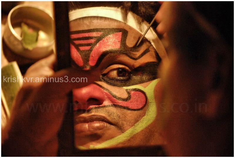 A kathakali Performer during makeup