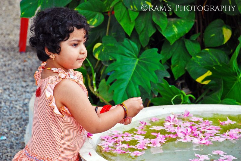 Sahana, playing with flowers....