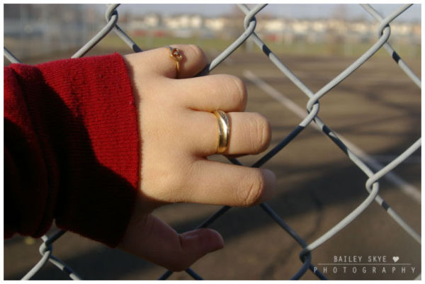 Gold Rings Contrast A Red Sweater