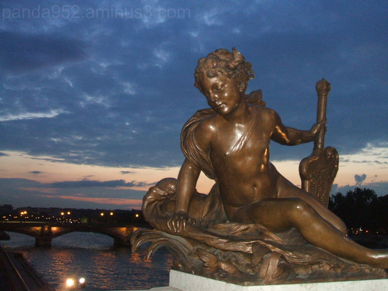 Angel statue on a Paris bridge