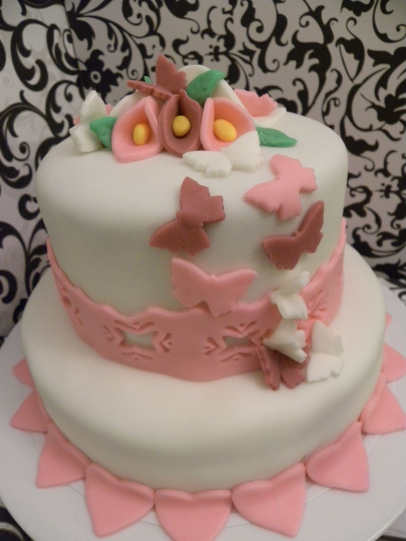 A hearts and butterflies wedding cake