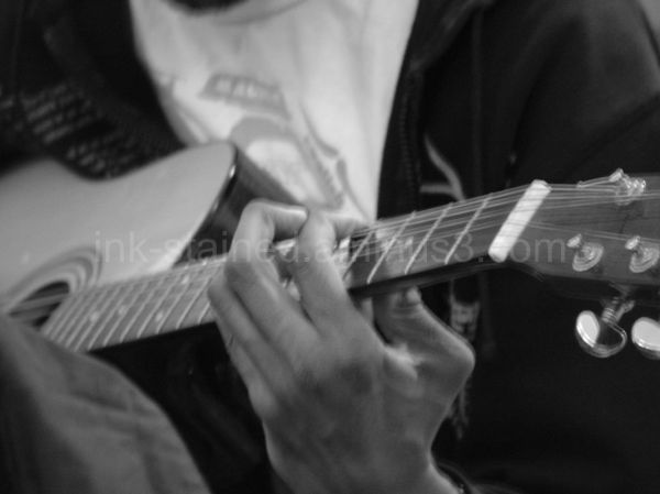 Closeup of hand and guitar