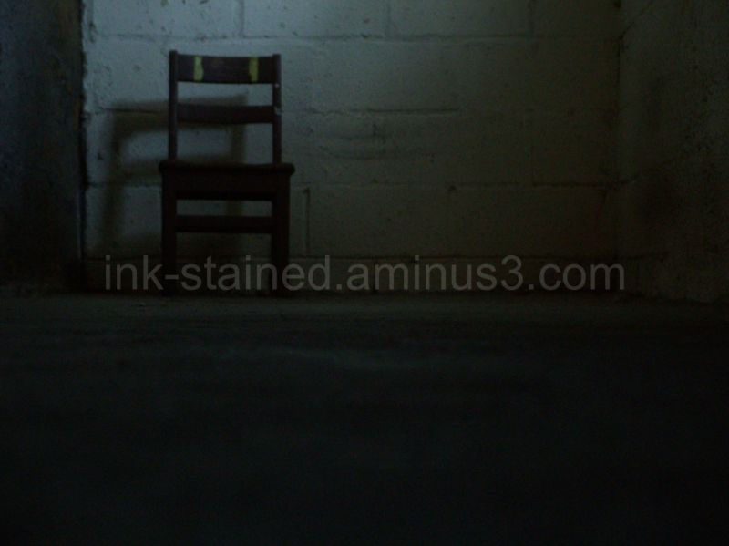 Lone chair in basement