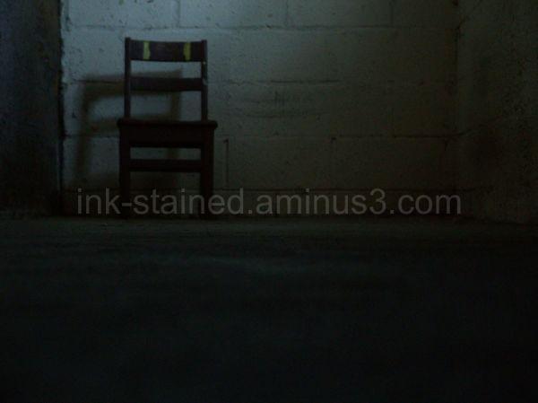 Lone chair in basement