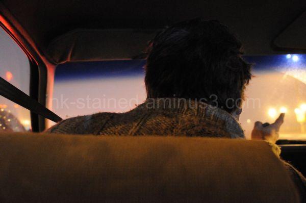 Man pointing to something in car