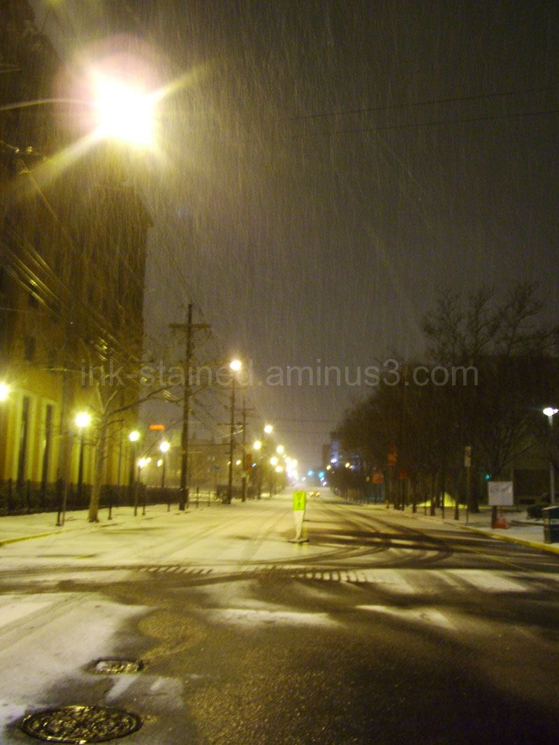 Empty road at night in snow