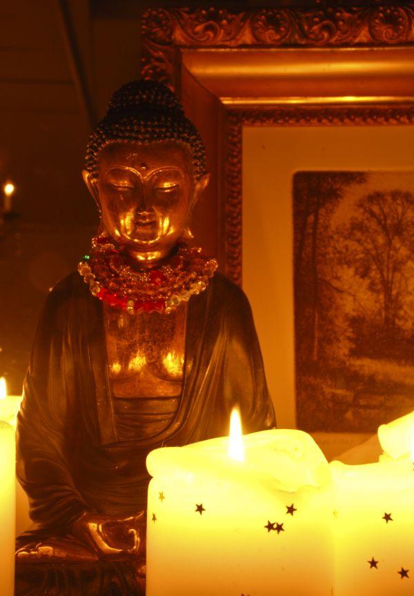 candle lit buddha
