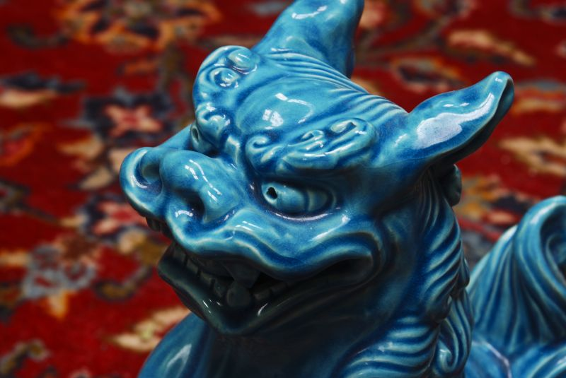 turquoise fu dog on Mashad oriental carpet