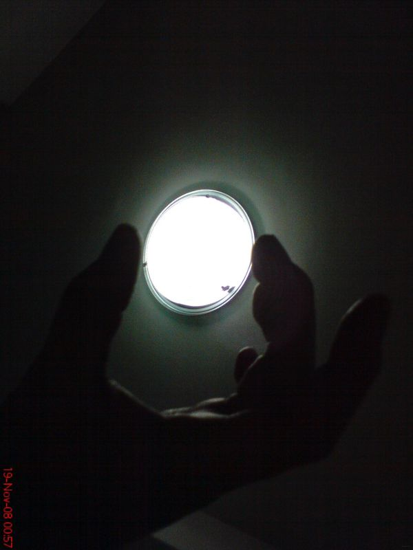 "hand ""holding"" light"