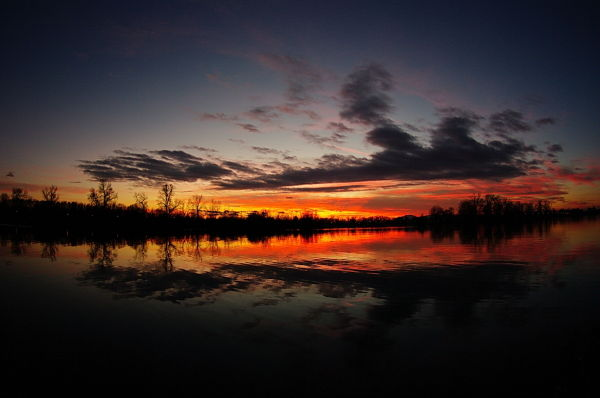 sunset on a lake taken by fisheye lens