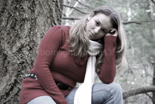 Girl posing in a tree