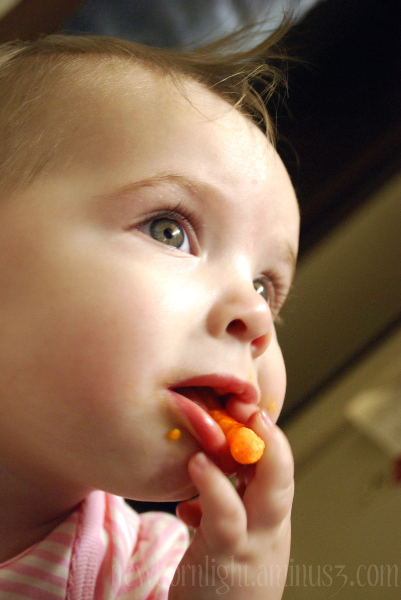 Baby eating a cheeto