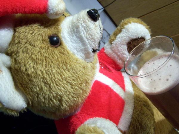 Cute Christmas teddy bear has his hot chocolate