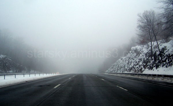 Frozen roads with freezing rain and fog
