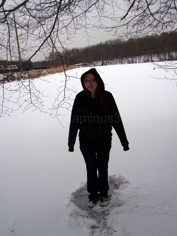 Girl walking on a frozen lake
