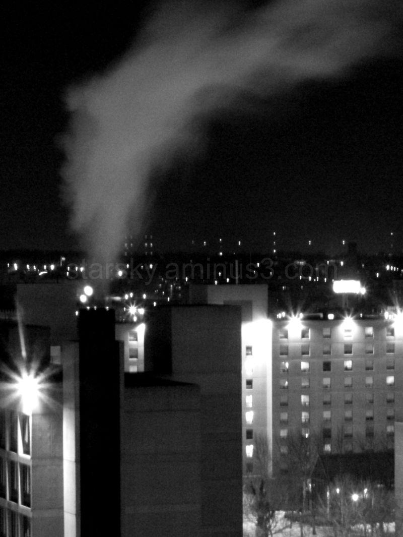 City smoke stack at night