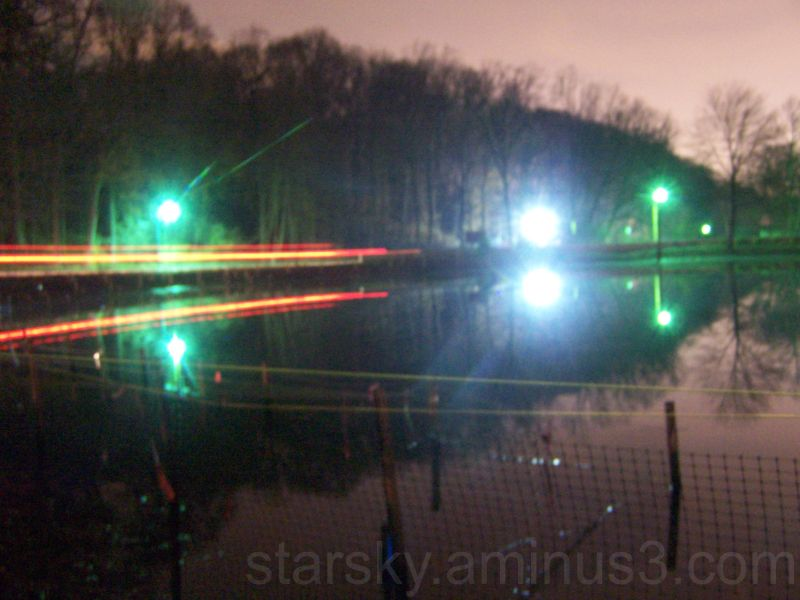 Light trails of a car speeding across the lake
