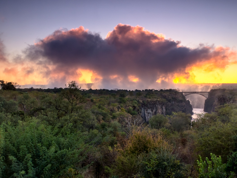 Mist of Victoria Falls at sunset