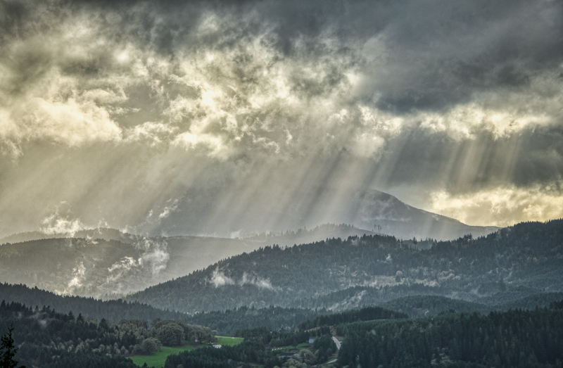 """Beams Breaking Thru Clouds Over the Coast Range"""