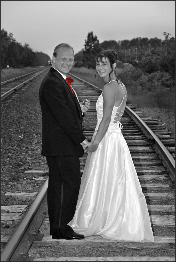 railroad tracks with couple