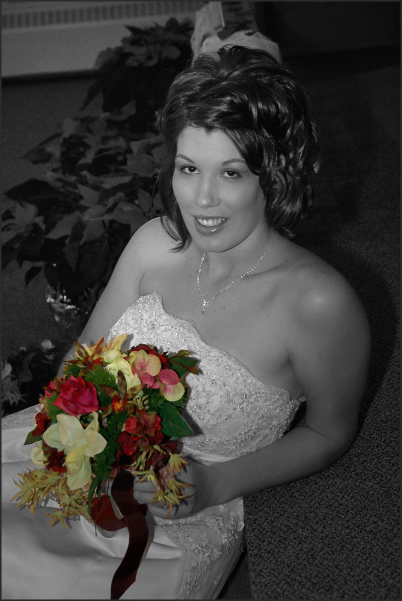 bride in b/w with colored flowers