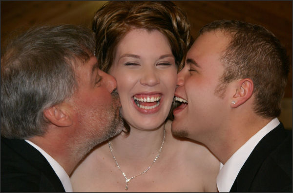 men kissing woman