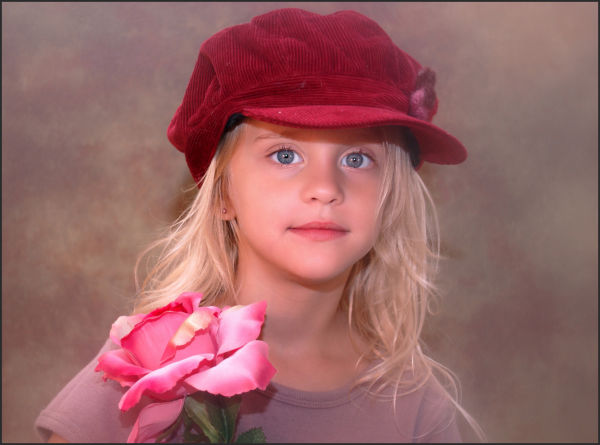 girl in hat with flower