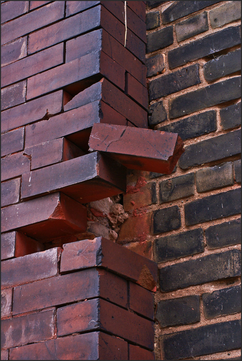 bricks loose on a wall