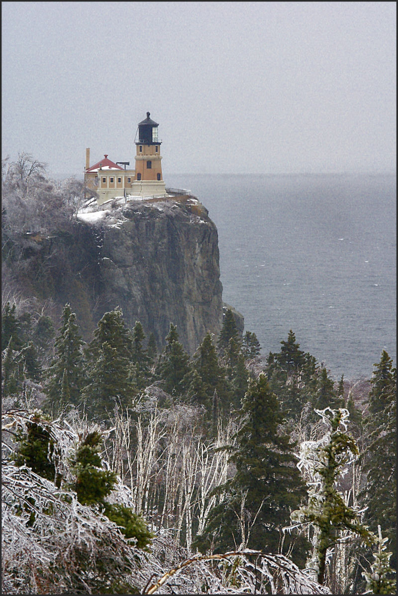 fog and ice storm over lighthouse