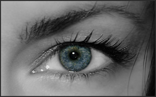 black and white eye with blue