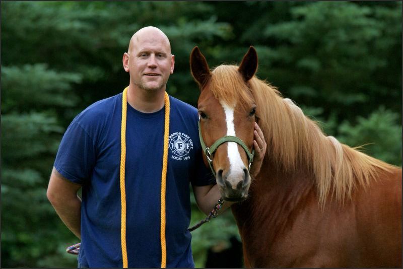 man and a horse, head shot