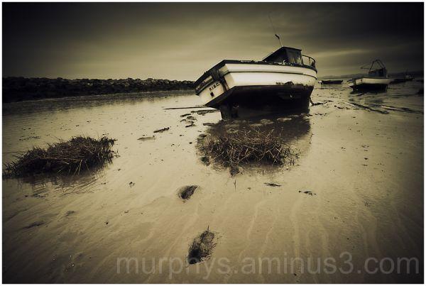 boats ,mud,coast.