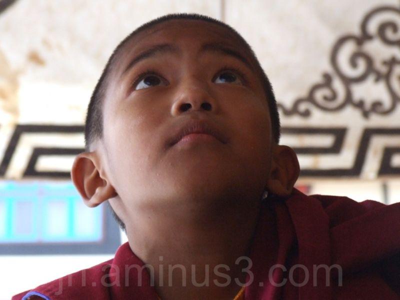 Buddhist boy playing game