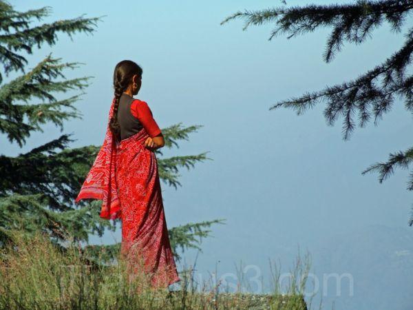 Indian woman looking at Himelayas