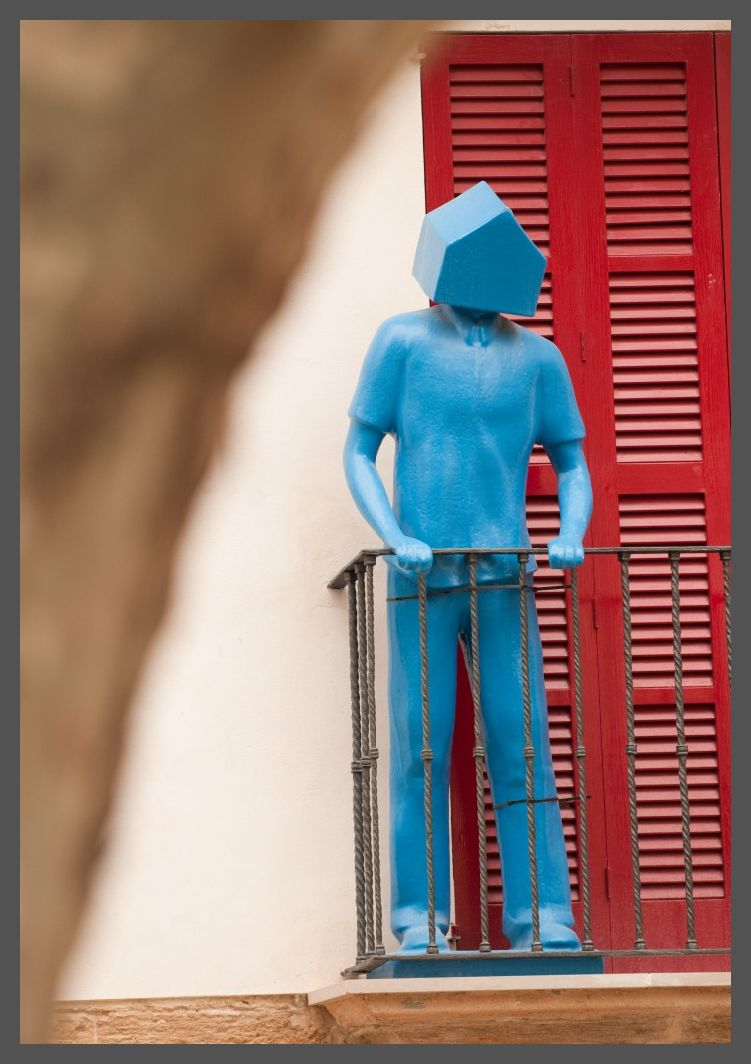 Blue man with house-head on balcony