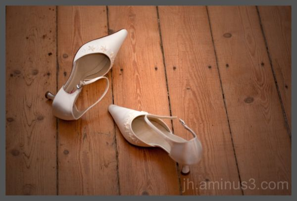 bride's shoes on the floor