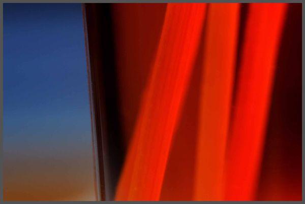 Red sticks behind glass 1