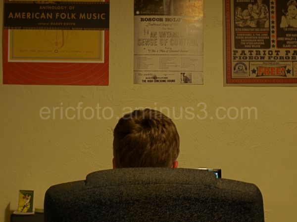 Photograph of Parker sitting at his computer.