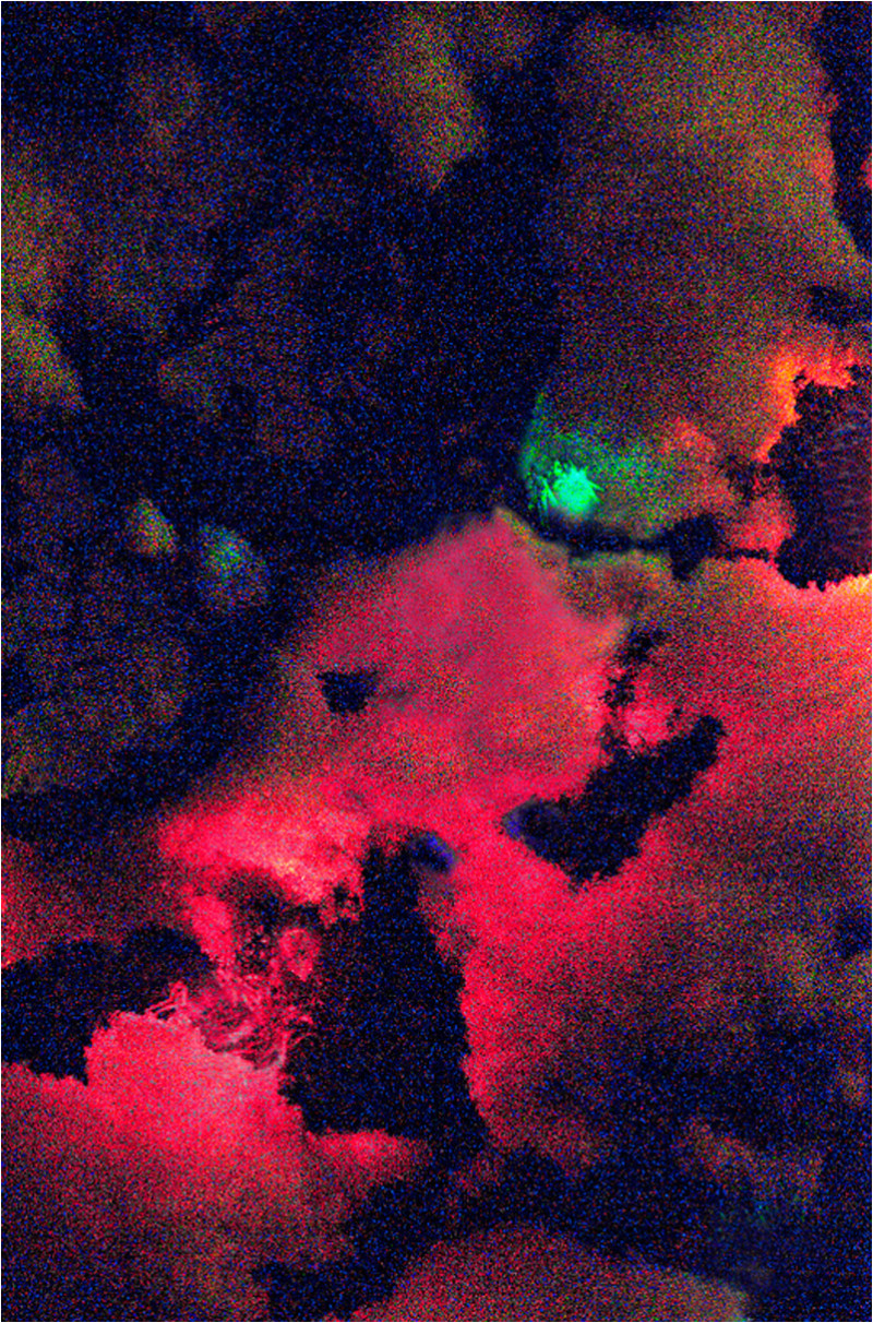 Abstract of Christmas lights in a snowy tree