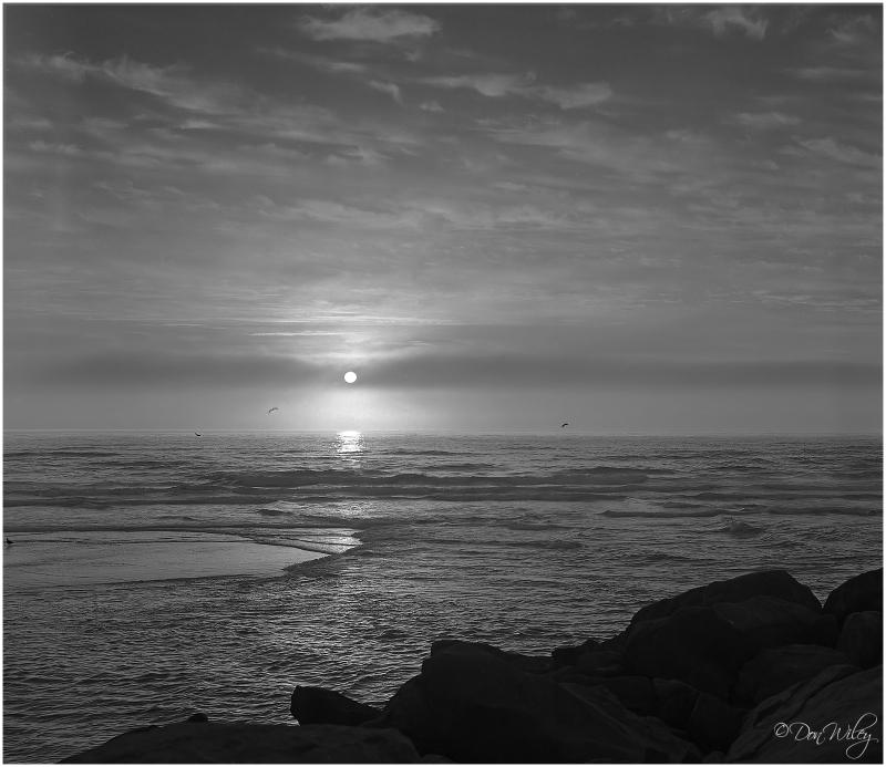 sunset ocean surf