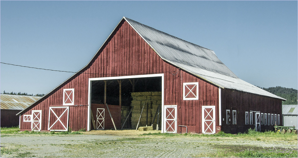 A barn featuring X