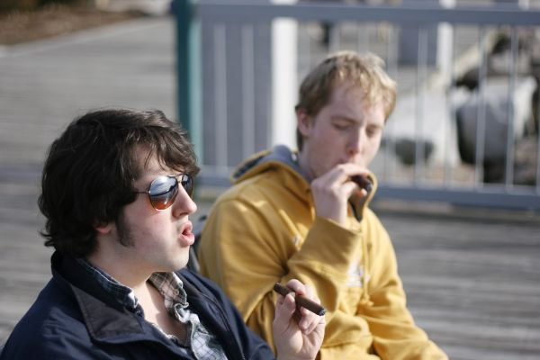 smoking cigars at the waterfront