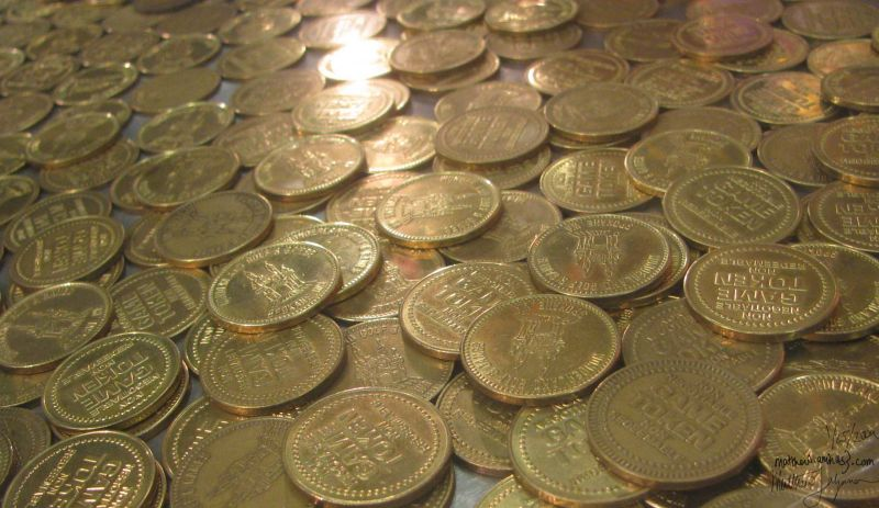A close up of some tokens for playing arcade games