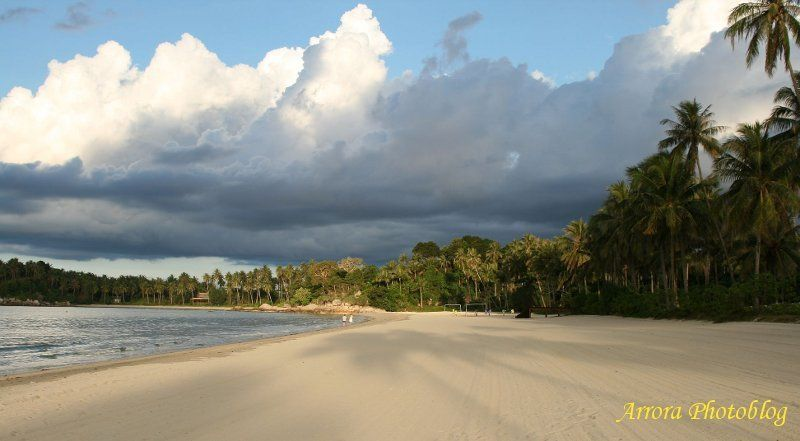 Serene beach with strong overcast clouds