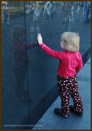 Curiosity of a little one at a war memorial