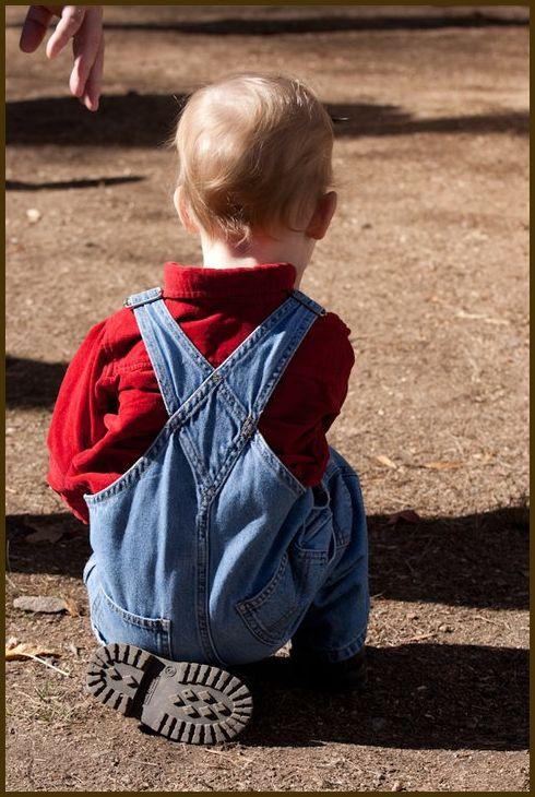 A little boy tired of walking.