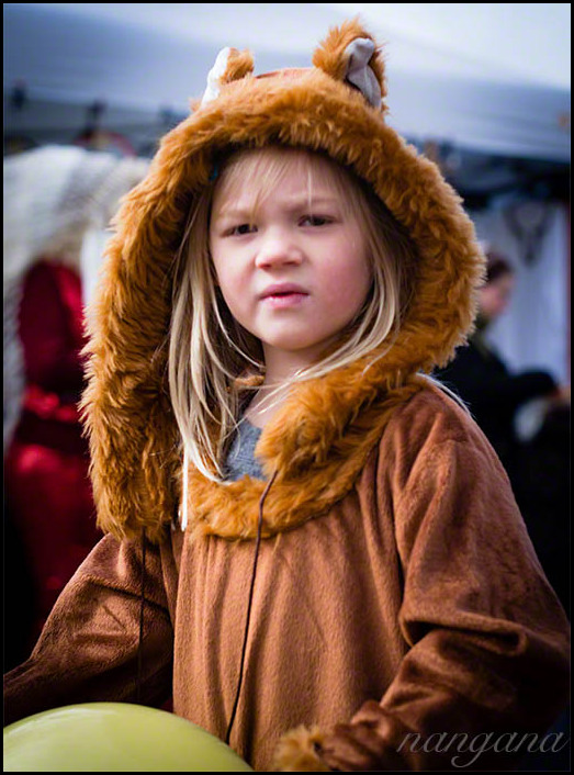 little girl in a lion costume