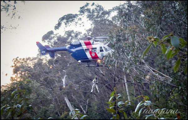 police rescue member winched out