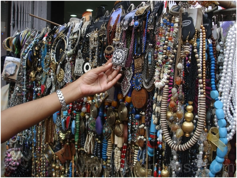 Hand in junk Jewelry shop