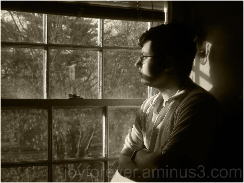 self portrait at window in sepia